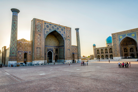 SAMARKAND, UZBEKISTAN - AUGUST 27: Visitors in front of Samarkand Registan in late afternoon. August 2016 Editorial