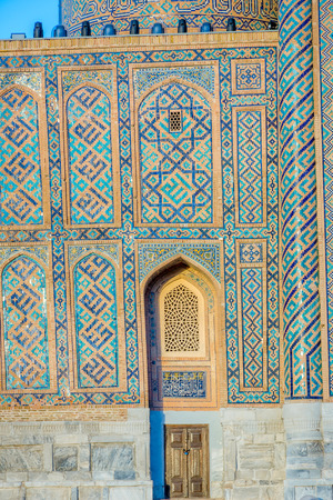 traditional pattern: Mosaic of blue tiles patterns on the wall of Samarkand Registan, Uzbekistan