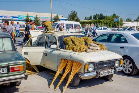 asian art: MARGILAN, UZBEKISTAN - AUGUST 21: Old Lada car with brooms for sale at Kumtepa bazaar. Market in one the the biggest in the area running once a week. August 2016
