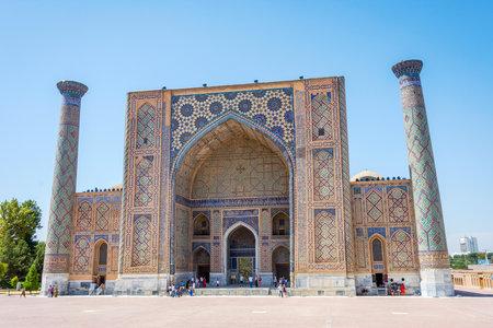 registan: SAMARKAND, UZBEKISTAN - AUGUST 28: People visiting Ulugh Beg Madrasah Madrasah in Registan famous landmark of Samarkand, Uzbekistan. August 2016