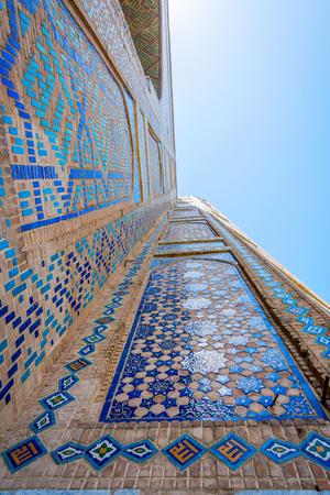 Colorful facade of mosaic and tiles detail of Registan mausoleum, Samarkand, Uzbekistan Stock Photo