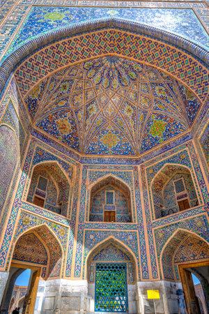 registan: Colorful facade and front side of Tilya Kori Madrasah in Registan, Samarkand, Uzbekistan
