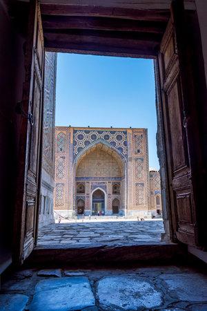 registan: SAMARKAND, UZBEKISTAN - AUGUST 28: People visiting Ulugh Beg Madrasah Madrasa in Registan famous landmark of Samarkand, Uzbekistan. August 2016 Editorial