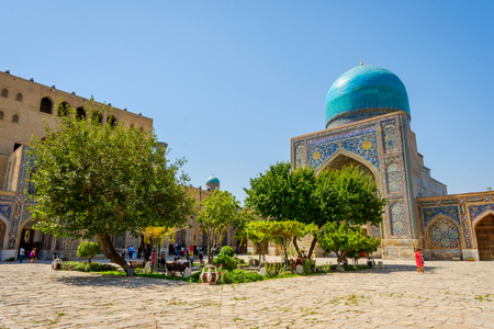 registan: SAMARKAND, UZBEKISTAN - AUGUST 28: People at atrium garden at Tilya Kori madrasah at Registan, Samarkand landmark. August 2016 Editorial