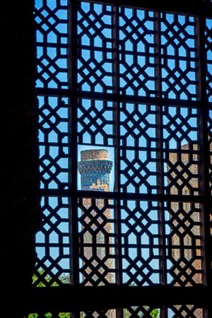 xv century: View to minaret thru the lattice window, Samarkand, Uzbekistan
