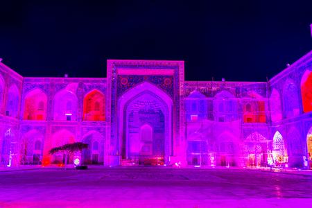 Illuminated atrium of Sher Dor madrasah at night, Registan, Samarkand, Uzbekistan Stock Photo