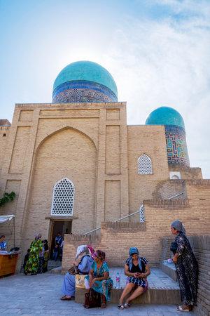 SAMARKAND, UZBEKISTAN - AUGUST 28: Women sitting on the stairs in front of Shah i Zinda mausoleum in Samarkand. August 2016
