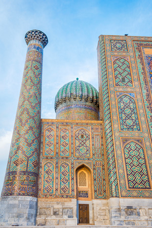 Minaret and dome with blue mosaic tiles, Registan, Samarkand, Uzbekistan