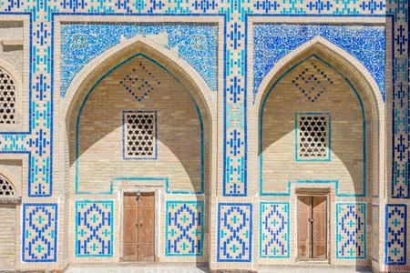 Arches with blue tiles mosaics on the madrassa, Bukhara, Uzbekistan