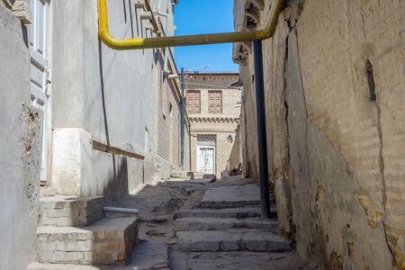 Local residential street in Bukhara, Uzbekistan Stock Photo