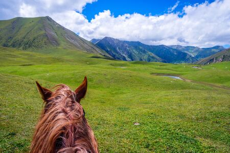 kyrgyzstan: View over green valley and mountains from the horse back, Altyn Arashan, Kyrgyzstan