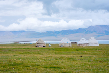 Yurts, typical nomad houses by the Song Kul lake, Kyrgyzstan Stock Photo