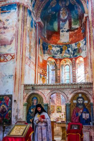 KUTAISI, GEORGIA - OCTOBER 22: Orthodox Priest at the ceremony in famous Gelati monastery. Monastery is part of Unesco world heritage. October 2016