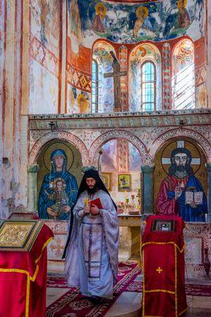 KUTAISI, GEORGIA - OCTOBER 22: Orthodox Priest at the ceremony in famous Gelati monastery. October 2016