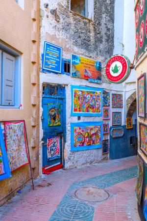 ESSAOUIRA, MOROCCO - DECEMBER 13: Art exposed in a narrow street in Essaouira old town. December 2016