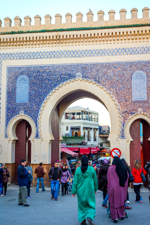 FEZ, MOROCCO - DECEMBER 9: People passing by the Fez old gate Bab Boujloud. December 2016 Editorial