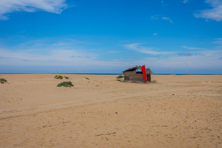 Wooden shelter on the sandy beach, Kalpitiya, Sri Lanka