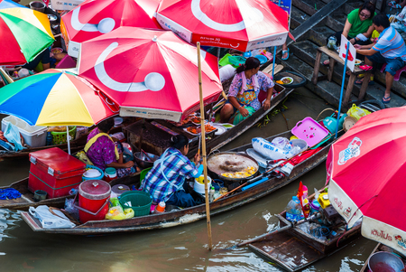 Amphawa, Thailand - Sep 13, 2015: Floating food market at Amphawa where food is cooked and prepared on the boats and serve to the people on the river canal bank Editorial