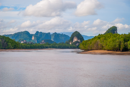 View over muddy Krabi river and scenic landscape of karst mountains, Thailand Imagens