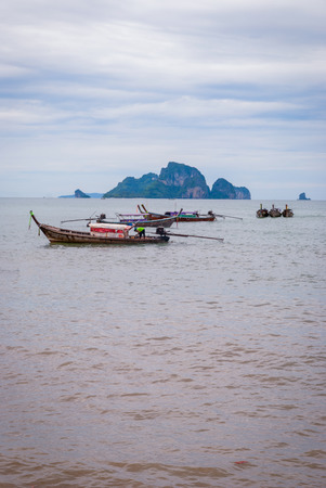 Typical thai boats on the beach in Krabi, Thailand