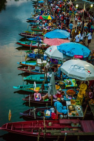 Hat Yai, Thailand - Oct 2015: Restaurants on the boats at the evening floating food market in Hat Yai, Thailand Editorial