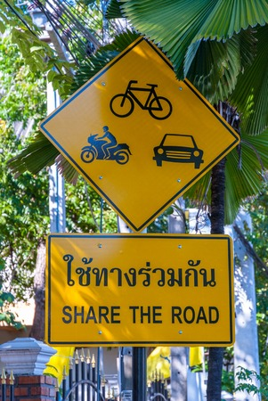 Road sign in thai to share the road
