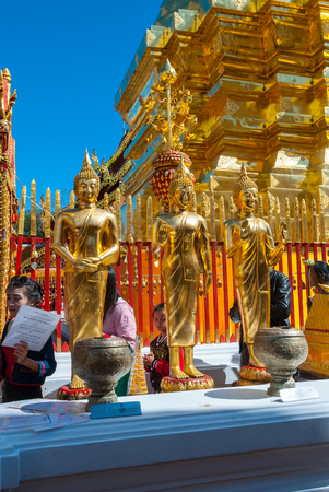Chiang Mai, Thailand - Dec 2015: People praying and giving offers at Doi Suthep temple. Editorial