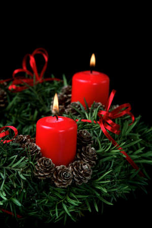Two red burning candles on advent wreath  photo