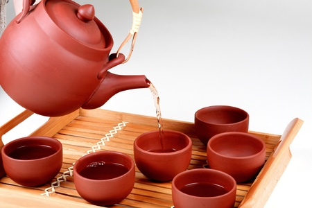 chinese tea ceremony: Pouring tea in clay cups