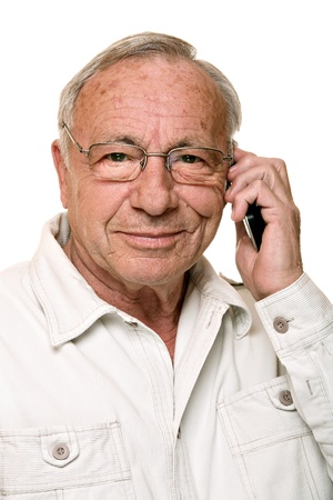 Portrait of a handsome senior man, using mobile phone, isolated on white  photo