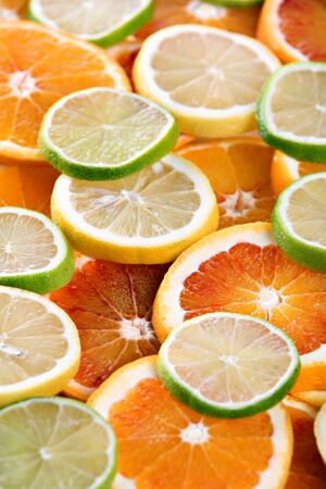 Slices of orange, lemon and limes - background Stock Photo - 8704997