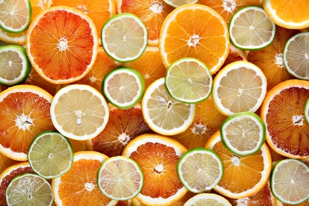 Slices of orange, lemon and limes - background Stock Photo - 8703661