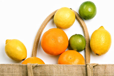 Citrus fruit and grocery shopping bag