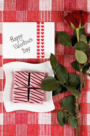 Valentines day card with rose and cakes  photo