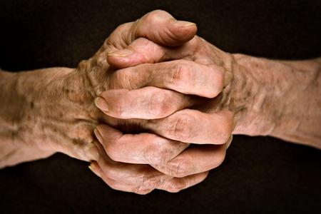 reverent: Senior hands praying