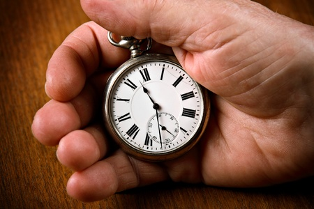 clock hands: Pocket watch in senior mans hand