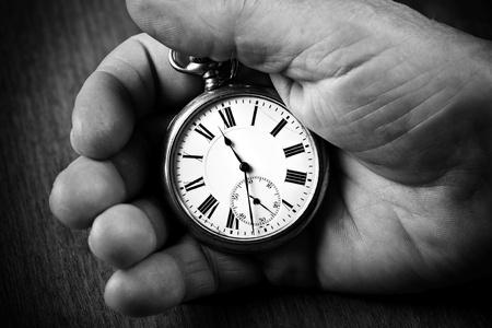 pocket watch: Pocket watch in senior mans hand