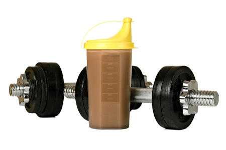 Protein shake in plastic shaker, with weights, isolated on white photo