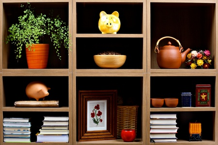 Beautiful wooden shelves with different home related  objects Stock Photo - 9169170