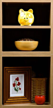 Beautiful wooden shelves with different home related  objects photo