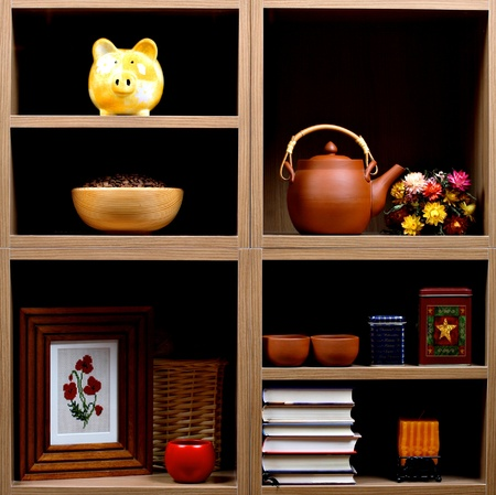 home related: Beautiful wooden shelves with different home related  objects Stock Photo