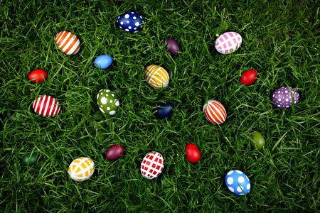 Hand-painted Easter eggs, hidden in the grass  photo