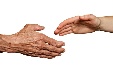 hands clasped: Old and young hands, isolated on white - two generations concept  Stock Photo