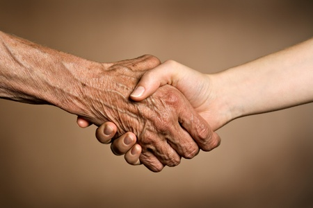 living together: Old and young hands - two generations concept  Stock Photo