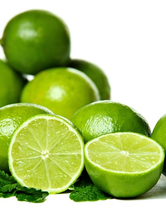 Fresh limes with mint, isolated on white