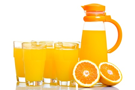 Pitcher and glasses full of juice, isolated on white