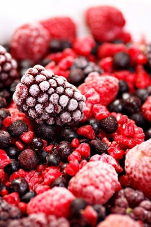 Stock Photo: Frozen forest fruits. Bright studio shot. Picture is not isolated but taken on a white plate. photo
