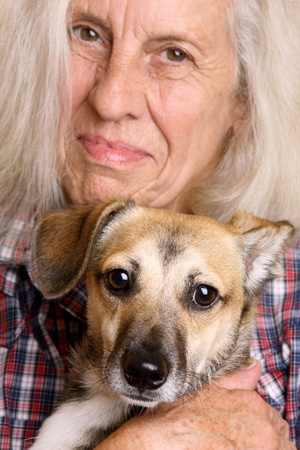 Beautiful senior woman with cute mixed breed puppy  photo