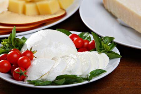Mozzarella with small tomatoes and basil photo