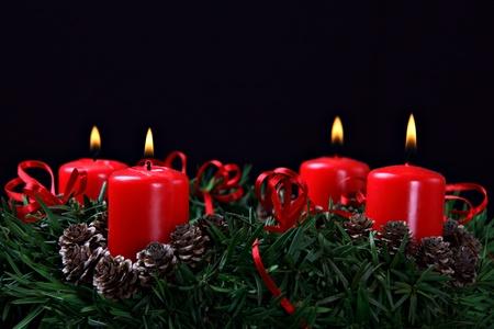 Advent wreath against black background  photo